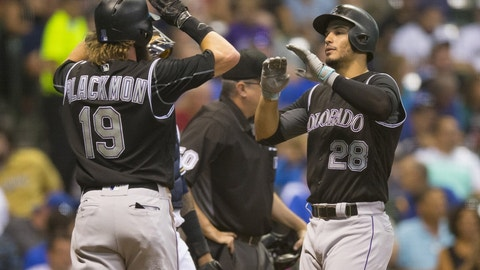 Aug 23, 2016; Milwaukee, WI, USA;  Colorado Rockies third baseman Nolan Arenado (28) celebrates with center fielder Charlie Blackmon (19) after hitting a home run during the third inning against the Milwaukee Brewers at Miller Park. Mandatory Credit: Jeff Hanisch-USA TODAY Sports