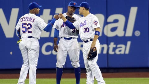 Sep 19, 2016; New York City, NY, USA; New York Mets outfielders Yoenis Cespedes (52), Curtis Granderson (3) and Michael Conforto (30) during a pitching change in the seventh inning against the Atlanta Braves at Citi Field. Mandatory Credit: Wendell Cruz-USA TODAY Sports