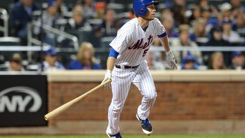 Sep 24, 2016; New York City, NY, USA; New York Mets left fielder Ty Kelly (56) hits an RBI sacrifice fly against the Philadelphia Phillies during the fifth inning at Citi Field. Mandatory Credit: Brad Penner-USA TODAY Sports