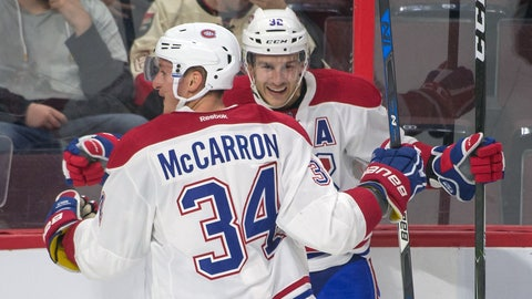 Oct 1, 2016; Ottawa, Ontario, CAN; Montreal Canadiens center Brian Flynn #32 celebrates with right wing Michael McCarron his goal scored against the Ottawa Senators with 36 seconds left in the third period of a preseason hockey game at Canadian Tire Centre. The Canadiens defeated the Senators 3-2. Mandatory Credit: Marc DesRosiers-USA TODAY Sports