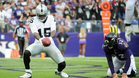 Oct 2, 2016; Baltimore, MD, USA; Oakland Raiders wide receiver Michael Crabtree (15) reacts after scoring a touchdown in front of Baltimore Ravens safety Eric Weddle (32) in the fourth quarter at M&T Bank Stadium. Mandatory Credit: Evan Habeeb-USA TODAY Sports