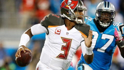 Oct 10, 2016; Charlotte, NC, USA;  Tampa Bay Buccaneers quarterback Jameis Winston (3) scrambles while Carolina Panthers defensive end Mario Addison (97) pursues in the third quarter at Bank of America Stadium. Mandatory Credit: Jeremy Brevard-USA TODAY Sports
