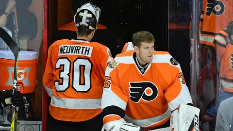 Oct 29, 2016; Philadelphia, PA, USA; Philadelphia Flyers goalie Michal Neuvirth (30) and goalie Steve Mason (35) react after time runs out during loss to the Pittsburgh Penguins at Wells Fargo Center. The Penguins defeated the Flyers, 5-4. Mandatory Credit: Eric Hartline-USA TODAY Sports