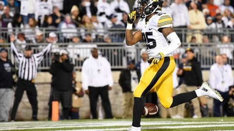 Nov 5, 2016; University Park, PA, USA; Iowa Hawkeyes running back Akrum Wadley (25) gestures to the crowd following his touchdown run against the Penn State Nittany Lions during the second quarter at Beaver Stadium. Mandatory Credit: Rich Barnes-USA TODAY Sports