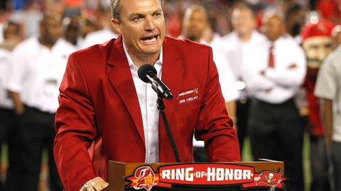 Nov 3, 2016; Tampa, FL, USA;  Tampa Bay Buccaneers former safety John Lynch addresses the crowd as his name is added to the Buccaneers Ring of Fame during the halftime ceremony  of a football game between the Tampa Bay Buccaneers and the Atlanta Falcons at Raymond James Stadium. Mandatory Credit: Reinhold Matay-USA TODAY Sports