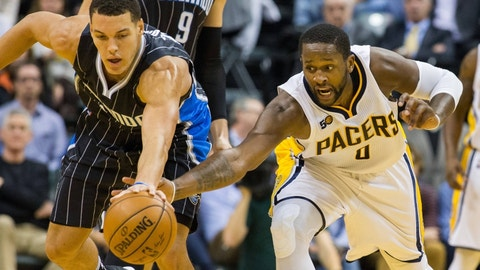 Nov 14, 2016; Indianapolis, IN, USA; Indiana Pacers forward C.J. Miles (0) steals the ball from Orlando Magic forward Aaron Gordon (00)  in the second half at Bankers Life Fieldhouse. Indiana Pacers beat the Orlando Magic 88-69. Mandatory Credit: Trevor Ruszkowski-USA TODAY Sports