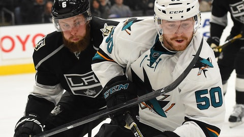 Nov 30, 2016; Los Angeles, CA, USA;   Los Angeles Kings defenseman Jake Muzzin (6) and San Jose Sharks center Chris Tierney (50) chase down the puck during the third period of the game at Staples Center. Sharks won 4-1. Mandatory Credit: Jayne Kamin-Oncea-USA TODAY Sports