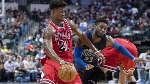 Dec 3, 2016; Dallas, TX, USA; Chicago Bulls forward Jimmy Butler (21) drives to the basket past Dallas Mavericks guard Wesley Matthews (23) during the second quarter at the American Airlines Center. Mandatory Credit: Jerome Miron-USA TODAY Sports