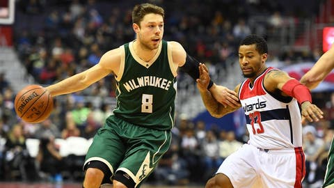 Dec 10, 2016; Washington, DC, USA; Milwaukee Bucks guard Matthew Dellavedova (8) dribbles past Washington Wizards guard Trey Burke (33) during the first half at Verizon Center. Mandatory Credit: Brad Mills-USA TODAY Sports