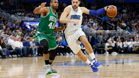 Dec 7, 2016; Orlando, FL, USA; Orlando Magic center Nikola Vucevic (9) drives to the basket as Boston Celtics center Al Horford (42) defends during the second quarter at Amway Center. Mandatory Credit: Kim Klement-USA TODAY Sports