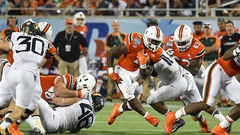 Dec 28, 2016; Orlando, FL, USA; Miami Hurricanes running back Gus Edwards (7) runs the ball against the West Virginia Mountaineers during the second half at Camping World Stadium. The Miami Hurricanes defeat the West Virginia Mountaineers 31-14. Mandatory Credit: Jasen Vinlove-USA TODAY Sports