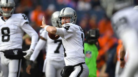 Jan 1, 2017; Denver, CO, USA; Oakland Raiders quarterback Matt McGloin (14) before the game against the Denver Broncos at Sports Authority Field. Mandatory Credit: Ron Chenoy-USA TODAY Sports