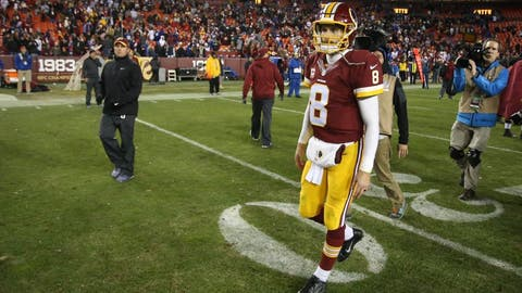 Jan 1, 2017; Landover, MD, USA; Washington Redskins quarterback Kirk Cousins (8) walks on the field after the Redskins' game against the New York Giants at FedEx Field. The Giants won 19-10. Mandatory Credit: Geoff Burke-USA TODAY Sports