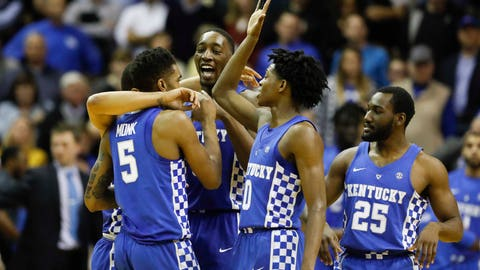 Jan 10, 2017; Nashville, TN, USA; Kentucky Wildcats guard Malik Monk (5) guard De'Aaron Fox (0) forward Edrice Bam Adebayo (3) and guard Dominique Hawkins (25) celebrate during the game against the Vanderbilt Commodores in the second half at Memorial Gymnasium. Kentucky defeated Vanderbilt 87-81. Mandatory Credit: Mark Zerof-USA TODAY Sports