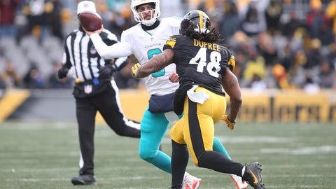 Jan 8, 2017; Pittsburgh, PA, USA; Miami Dolphins quarterback Matt Moore (8) passes against pressure from Pittsburgh Steelers outside linebacker Bud Dupree (48) during the second quarter in the AFC Wild Card playoff football game at Heinz Field. The Steelers won 30-12. Mandatory Credit: Charles LeClaire-USA TODAY Sports