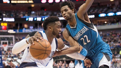 Jan 15, 2017; Dallas, TX, USA; Dallas Mavericks guard Wesley Matthews (23) drives to the basket against Minnesota Timberwolves forward Andrew Wiggins (22) during the first quarter at the American Airlines Center. Mandatory Credit: Jerome Miron-USA TODAY Sports