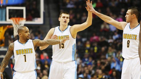 Jan 16, 2017; Denver, CO, USA; Denver Nuggets forward Danilo Gallinari (8), Denver Nuggets forward Nikola Jokic (15), and Denver Nuggets guard Jameer Nelson (1) celebrate during the first half against the Orlando Magic at Pepsi Center. Mandatory Credit: Chris Humphreys-USA TODAY Sports