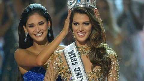 Miss Universe contestant Iris Mittenaere (R) of France is crowned the new 2017 winner by former Miss Universe Pia Wurtzbach of the Philippines (L) during the Miss Universe pageant at the Mall of Asia Arena in Manila on January 30, 2017.France was crowed Miss Universe on January 30 in a glitzy spectacle free of last year's dramatic mix-up but with a dash of political controversy as finalists touched on migration and other hot-button global issues. / AFP / TED ALJIBE        (Photo credit should read TED ALJIBE/AFP/Getty Images)