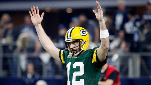 ARLINGTON, TX - JANUARY 15:  Aaron Rodgers #12 of the Green Bay Packers reacts after scoring a touchdown in the first half during the NFC Divisional Playoff Game against the Dallas Cowboys at AT&T Stadium on January 15, 2017 in Arlington, Texas. (Photo by Joe Robbins/Getty Images)