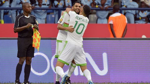 Algeria's forward Riyad Mahrez (back) celebrates with Algeria's midfielder Nabil Bentaleb after scoring a goal during the 2017 Africa Cup of Nations group B football match between Algeria and Zimbabwe in Franceville on January 15, 2017. / AFP / KHALED DESOUKI        (Photo credit should read KHALED DESOUKI/AFP/Getty Images)