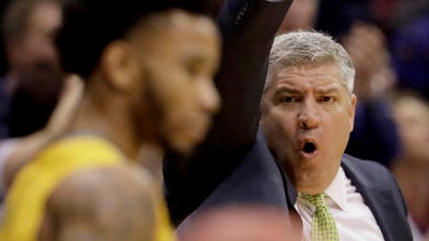Siena head coach Jimmy Patsos talks to his players during the first half of an NCAA college basketball game against Kansas Friday, Nov. 18, 2016, in Lawrence, Kan. (AP Photo/Charlie Riedel)