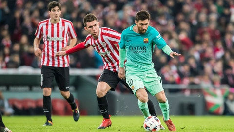 BILBAO, SPAIN - JANUARY 06: Lionel Andres Messi (r) of FC Barcelona is followed by Aymeric Laporte of Athletic Club during their Copa del Rey Round of 16 first leg match between Athletic Club and FC Barcelona at San Mames Stadium on 05 January 2017 in Bilbao, Spain. (Photo by Victor Fraile/Power Sport Images/Getty Images)