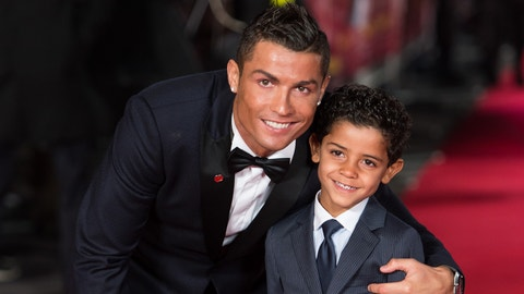 """LONDON, ENGLAND - NOVEMBER 09:  Cristiano Ronaldo and son Cristiano Ronaldo Jr attend the World Premiere of """"Ronaldo"""" at Vue West End on November 9, 2015 in London, England.  (Photo by Ian Gavan/Getty Images)"""