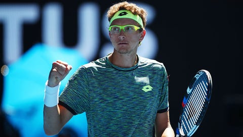 MELBOURNE, AUSTRALIA - JANUARY 19:  Denis Istomin of Uzbekistan celebrates in his second round match against Novak Djokovic of Serbia on day four of the 2017 Australian Open at Melbourne Park on January 19, 2017 in Melbourne, Australia.  (Photo by Clive Brunskill/Getty Images)