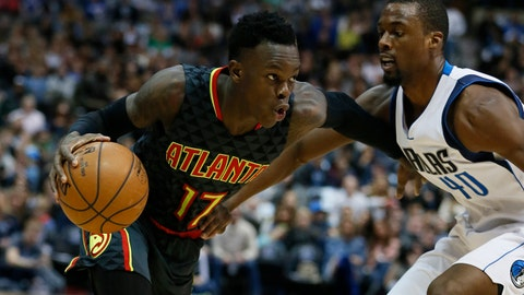 Jan 7, 2017; Dallas, TX, USA; Atlanta Hawks guard Dennis Schroder (17) drives on Dallas Mavericks forward Harrison Barnes (40) in the second quarter at American Airlines Center. Mandatory Credit: Tim Heitman-USA TODAY Sports
