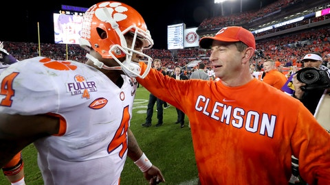 TAMPA, FL - JANUARY 09:  Quarterback Deshaun Watson #4 greets head coach Dabo Swinney of the Clemson Tigers after defeating the Alabama Crimson Tide 35-31 to win the 2017 College Football Playoff National Championship Game at Raymond James Stadium on January 9, 2017 in Tampa, Florida.  (Photo by Tom Pennington/Getty Images)