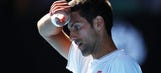 Six-time champ Novak Djokovic stunned by qualifier Denis Istomin at Australian Open