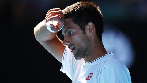 MELBOURNE, AUSTRALIA - JANUARY 19:  Novak Djokovic of Serbia looks on in his second round match against Denis Istomin of Uzbekistan on day four of the 2017 Australian Open at Melbourne Park on January 19, 2017 in Melbourne, Australia.  (Photo by Clive Brunskill/Getty Images)
