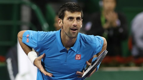 Serbia's Novak Djokovic celebrates after winning against Argentina's Horacio Zeballos during the second round of the ATP Qatar Open tennis competition in Doha on January 4, 2017. / AFP / KARIM JAAFAR        (Photo credit should read KARIM JAAFAR/AFP/Getty Images)