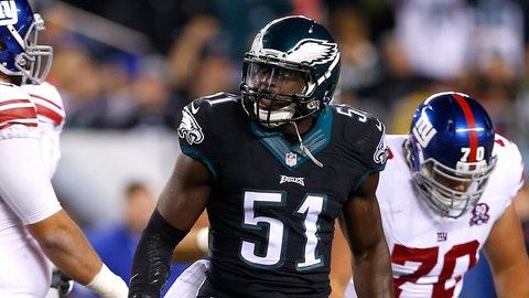 Philadelphia Eagles inside linebacker Emmanuel Acho (51) celebrates after making a hit on New York Giants quarterback Eli Manning, bottom, during the first half of an NFL football game, Sunday, Oct. 12, 2014, in Philadelphia. (AP Photo/Michael Perez)