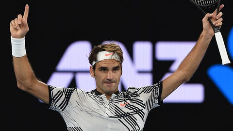 Switzerland's Roger Federer celebrates his win against Switzerland's Stanislas Wawrinka during their men's singles semi-final match on day 11 of the Australian Open tennis tournament in Melbourne on January 26, 2017. / AFP / PAUL CROCK / IMAGE RESTRICTED TO EDITORIAL USE - STRICTLY NO COMMERCIAL USE        (Photo credit should read PAUL CROCK/AFP/Getty Images)