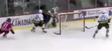 Watch a hockey goalie score a goal from behind his own net