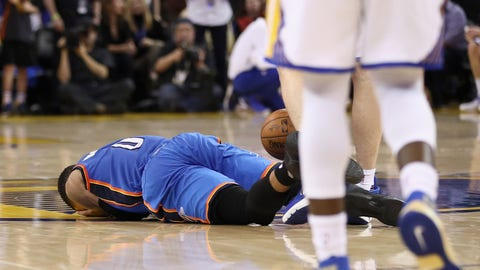 OAKLAND, CA - JANUARY 18:  Russell Westbrook #0 of the Oklahoma City Thunder lies on the court after being fouled by Zaza Pachulia #27 of the Golden State Warriors at ORACLE Arena on January 18, 2017 in Oakland, California.  NOTE TO USER: User expressly acknowledges and agrees that, by downloading and or using this photograph, User is consenting to the terms and conditions of the Getty Images License Agreement.  (Photo by Ezra Shaw/Getty Images)