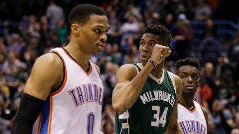 Milwaukee Bucks' Giannis Antetokounmpo (34) pumps his fist as Oklahoma City Thunder's Russell Westbrook (0) and Jerami Grant (9) leave the floor after an NBA basketball game Monday, Jan. 2, 2017, in Milwaukee. The Bucks won 98-94. Antetokounmpo had 26 points. (AP Photo/Jeffrey Phelps)