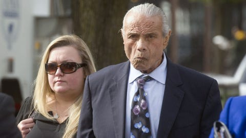 "Former professional wrestler Jimmy ""Superfly"" Snuka, right, arrives for his formal arraignment at the Lehigh County Courthouse in Allentown, Pa. on Monday, Nov. 2, 2015. Snuka has pleaded not guilty to third-degree murder charges in the death of his mistress more than three decades ago. (Michael Kubel/The Morning Call via AP) THE EXPRESS-TIMES OUT; WFMZ OUT; MANDATORY CREDIT"