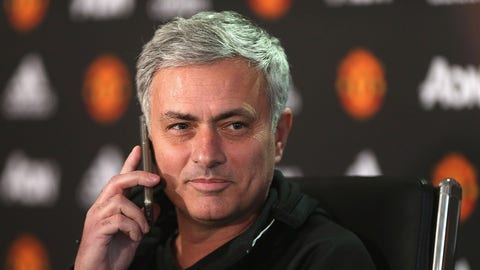 MANCHESTER, ENGLAND - JANUARY 13:  (EXCLUSIVE COVERAGE) Manager Jose Mourinho of Manchester United answers a journalist's telephone during a press conference at Aon Training Complex on January 13, 2017 in Manchester, England.  (Photo by John Peters/Man Utd via Getty Images)