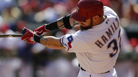 Oct 3, 2015; Arlington, TX, USA; Texas Rangers left fielder Josh Hamilton (32) follows through on his solo home run against the Los Angeles Angels during the seventh inning of a baseball game at Globe Life Park in Arlington. The Angels won 11-10. Mandatory Credit: Jim Cowsert-USA TODAY Sports