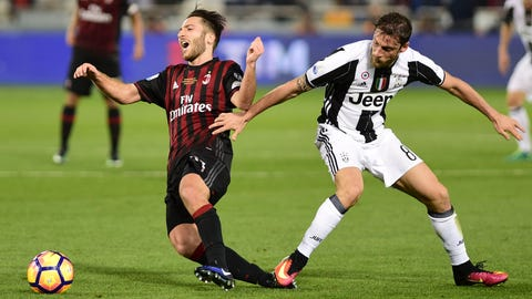 AC Milan's Andrea Bertolacci, left, is challenged by Juventus's Claudio Marchisio during the Italian Super Cup soccer match between Juventus and AC Milan, at the Al Sadd Sports Club in Doha, Qatar, Friday, Dec. 23, 2016. (AP Photo/Alexandra Panagiotidou)