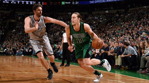 BOSTON, MA - NOVEMBER 25: Kelly Olynyk #41 of the Boston Celtics drives to the basket during the game against the San Antonio Spurs on November 25, 2016 at TD Garden in Boston, Massachusetts. NOTE TO USER: User expressly acknowledges and agrees that, by downloading and or using this Photograph, user is consenting to the terms and conditions of the Getty Images License Agreement. Mandatory Copyright Notice: Copyright 2016 NBAE (Photo by Brian Babineau/NBAE via Getty Images)