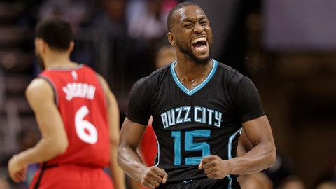 Charlotte Hornets' Kemba Walker (15) reacts to making a basket against the Toronto Raptors during the second half of an NBA basketball game in Charlotte, N.C., Friday, Jan. 20, 2017. (AP Photo/Chuck Burton)