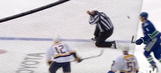 NHL linesman shakes off a puck straight to the head