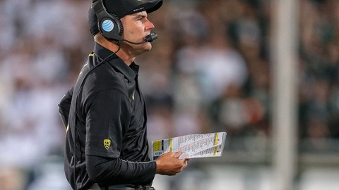 Sep 12, 2015; East Lansing, MI, USA; Oregon Ducks head coach Mark Helfrich walks the sidelines during the 2nd half of a game against Michigan State at Spartan Stadium. MSU won 31-28. Mandatory Credit: Mike Carter-USA TODAY Sports