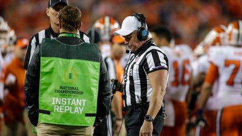 TAMPA, FL - JANUARY 09: Referee Mike Defee reviews a replay during the College Football Playoff National Championship game between the Alabama Crimson Tide and the Clemson Tigers on January 9, 2017, at Raymond James Stadium in Tampa, FL. Clemson won the game 35-31. (Photo by David Rosenblum/Icon Sportswire) (Icon Sportswire via AP Images)