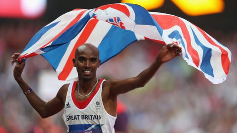 LONDON, ENGLAND - AUGUST 11:  Mohamed Farah of Great Britain holds a union jack aloft as he celebrates winning gold in the Men's 5000m Final on Day 15 of the London 2012 Olympic Games at Olympic Stadium on August 11, 2012 in London, England.  (Photo by Clive Brunskill/Getty Images)