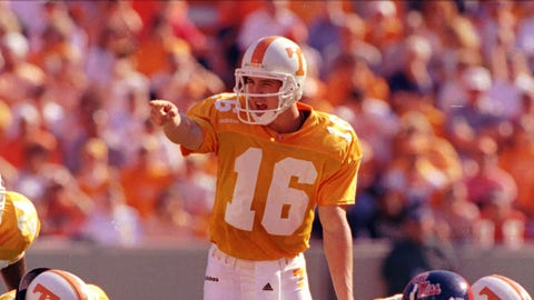 Tennessee quarterback Peyton Manning (16) directs a play during their 31-17 win over Ole Miss on Saturday, Oct. 4, 1997 in Knoxville, Tenn. Manning threw for 324 yards and two touchdowns. (AP Photo/Mark Humphrey)