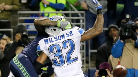 Seattle Seahawks wide receiver Paul Richardson, left, reaches around Detroit Lions strong safety Tavon Wilson (32) to make a catch for a touchdown in the first half of an NFL football NFC wild card playoff game, Saturday, Jan. 7, 2017, in Seattle. (AP Photo/Stephen Brashear)